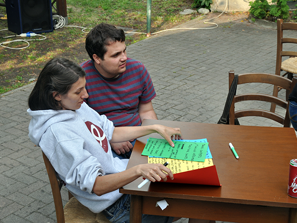 Adela and Mihai with coloured paper